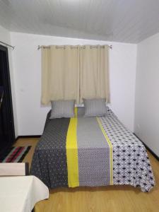 Cama ou camas em um quarto em Monoihere Bungalow Airport