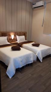 Cama ou camas em um quarto em منتجع هدا الأحلام