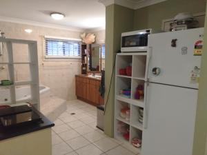 A kitchen or kitchenette at Homestay at Julie's