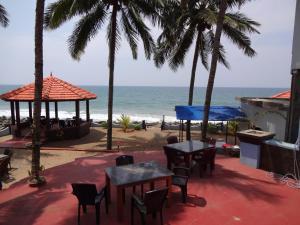 En restaurant eller et andet spisested på Samsara Harmony Beach Resort
