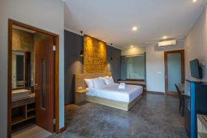 A bed or beds in a room at Atania Apartment