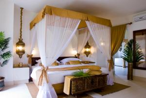 A bed or beds in a room at Baraza Resort and Spa Zanzibar