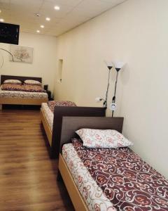 A bed or beds in a room at Viesu māja Baltika