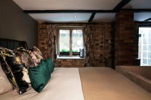 A bed or beds in a room at Hotel du Vin & Bistro Cambridge
