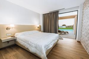 Een bed of bedden in een kamer bij Kresten Palace Hotel