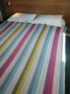 A bed or beds in a room at SUN1 ALBERTON