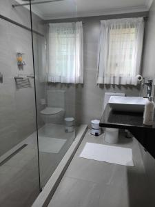 A bathroom at St. Lucia Wetlands Guest House