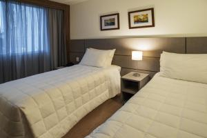 Cama ou camas em um quarto em Hotel Laghetto Viverone Moinhos