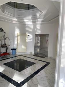 A cozinha ou cozinha compacta de فندق النخيل السليل