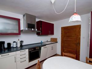 A kitchen or kitchenette at Classy Holiday Home in Schnabelwaid bei Bayreuth with Sauna