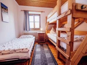 A bunk bed or bunk beds in a room at Classy Holiday Home in Schnabelwaid bei Bayreuth with Sauna