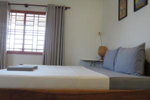 A bed or beds in a room at Sorya Guesthouse