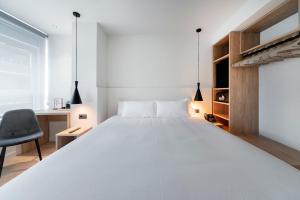 Cama o camas de una habitación en Hotel Distrito Oeste