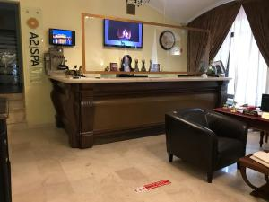 The lobby or reception area at Rossi Boutique Hotel