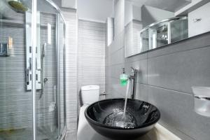 A bathroom at Apartments Tina FREE transfer from-to the airport