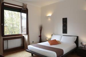Кровать или кровати в номере Residenza Delle Arti