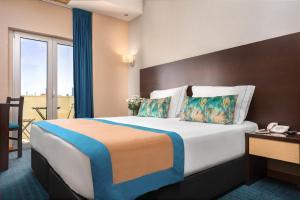 Cama o camas de una habitación en Hotel DAH - Dom Afonso Henriques