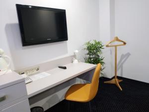 Телевизор и/или развлекательный центр в Гостиница Премьер