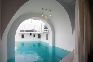 The swimming pool at or near Kouros Exclusive Hotel & Suites - Adults Only