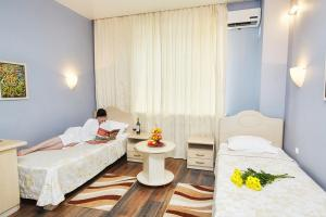 Кровать или кровати в номере Гостиница Чалпан