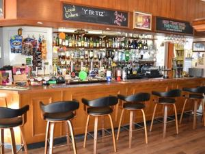 The lounge or bar area at The Sandrock Lynton