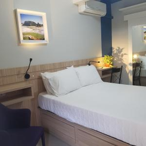 A bed or beds in a room at Tulipa Hotel