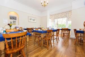A restaurant or other place to eat at The Rosscourt-Adults Only