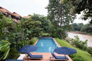 The swimming pool at or near Raya Heritage