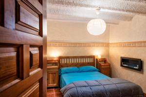 A bed or beds in a room at Finca Jabali