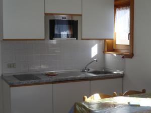 Kuchyň nebo kuchyňský kout v ubytování Casa Gembre