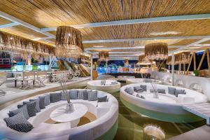 A restaurant or other place to eat at Kouros Exclusive Hotel & Suites - Adults Only