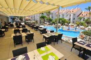 A restaurant or other place to eat at Paradise Park Fun Lifestyle Hotel