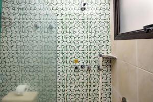 A bathroom at Yak Beach Hotel Ponta Negra
