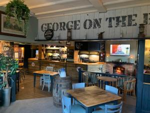 A restaurant or other place to eat at The George Inn Middle Wallop
