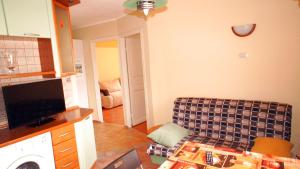 Кровать или кровати в номере Апартаменты Новоалексеевская