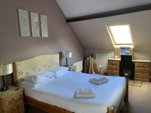 A bed or beds in a room at The Cromwell Arms Inn