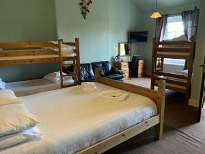A bunk bed or bunk beds in a room at The Cromwell Arms Inn