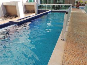 The swimming pool at or close to Flat Particular Brasilia 1004 / 1006