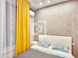 A bed or beds in a room at Лофт в ЖК Match Point на Парке Победы
