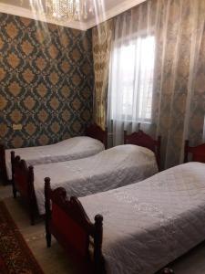 Cama ou camas em um quarto em Quba Villa