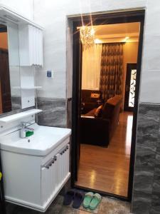 Um banheiro em Quba Villa