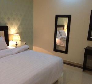 Cama ou camas em um quarto em Jaww Altamayoz Suites