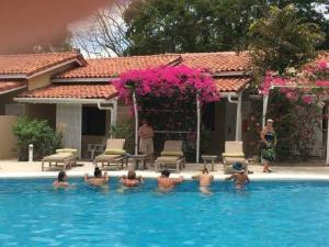 The swimming pool at or near Seis Playas Hotel