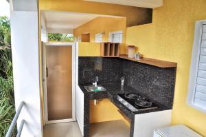 Küche/Küchenzeile in der Unterkunft De luz Hotel