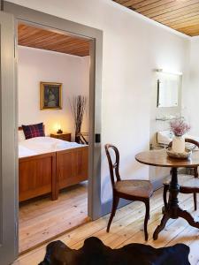 A bed or beds in a room at Le Vieux Hotel du Glacier et Poste