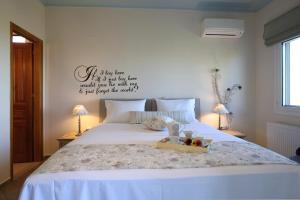 Letto o letti in una camera di Alea Resort Villas