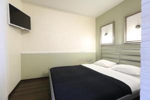 Кровать или кровати в номере MaxRealty24 Putilkovo