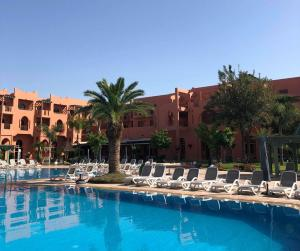 The swimming pool at or near Palm Plaza Hôtel & Spa