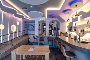 A restaurant or other place to eat at N E P center Hotel Rodos