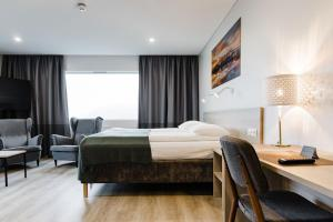 A bed or beds in a room at Hotel Katla by Keahotels